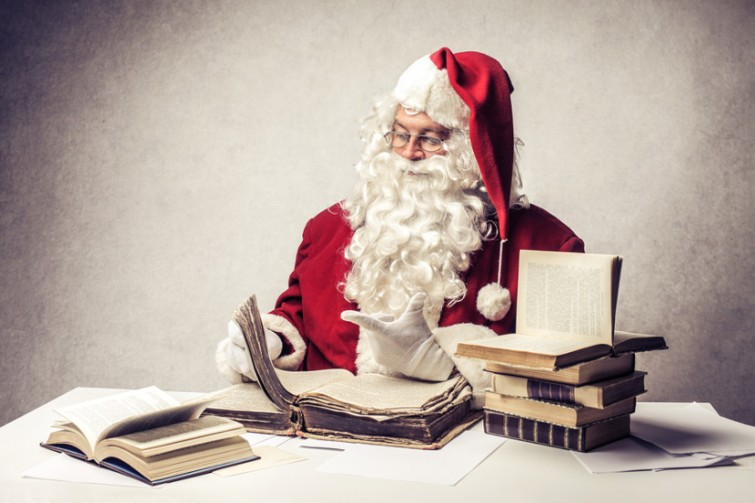 Santa Claus reads old books